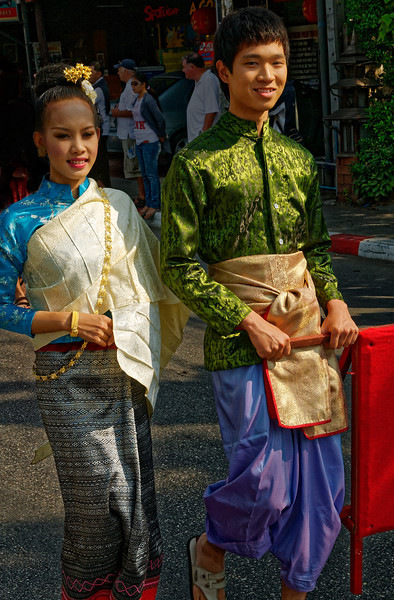 Thai silk—tastefully luxurious, richly colored, intricately patterned—is much in evidence among those marching in the parade, all of whom wear traditional attire.
