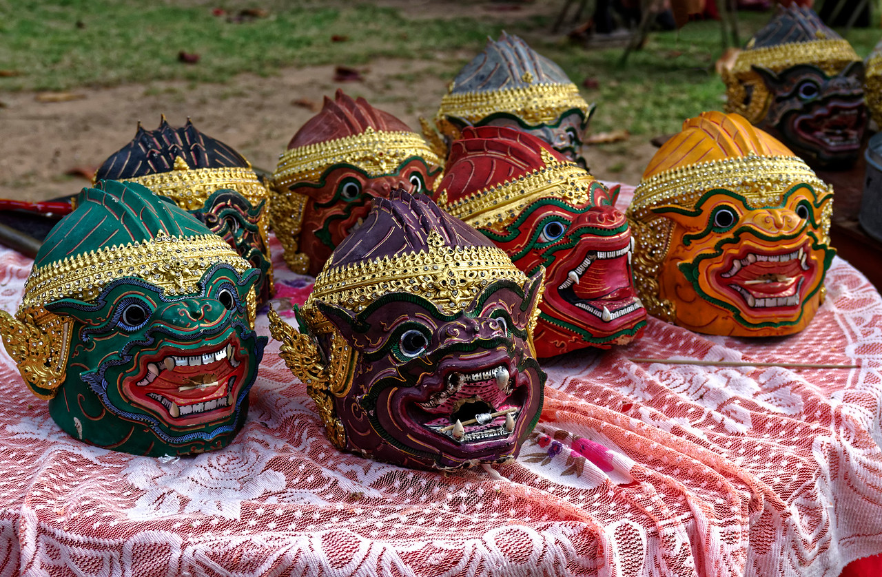 The papier-maché masks are made to cover the entire head of the wearer. Each has its own unique distinguishing traits, including color, to identify the character it represents.These masks represent some of the monkey warriors.