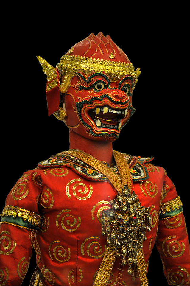 The facial characteristics and the elaborate accouterments worn by the <i>lakhon lek</i> puppets are replicas in miniature of the masks and costumes worn by their <i>khon</i> counterparts.
