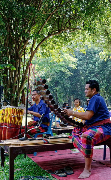 Local musicians playing traditional Isaan music on traditional instruments. The xylophone-like instrument in the foreground is a <i>pong lang.</i>