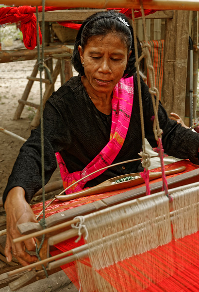 A Suay woman demonstrating the technique of handlooming silk. Silk fragments over 4,000 years old were among the artifacts excavated at Ban Chiang, in northern Isaan, and techniques of silk making have been passed on among Isaan women for countless generations.