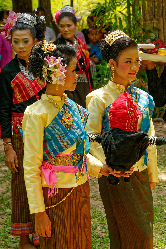 These two Suay women lead a ritual procession honoring the spirits of their ancestors.