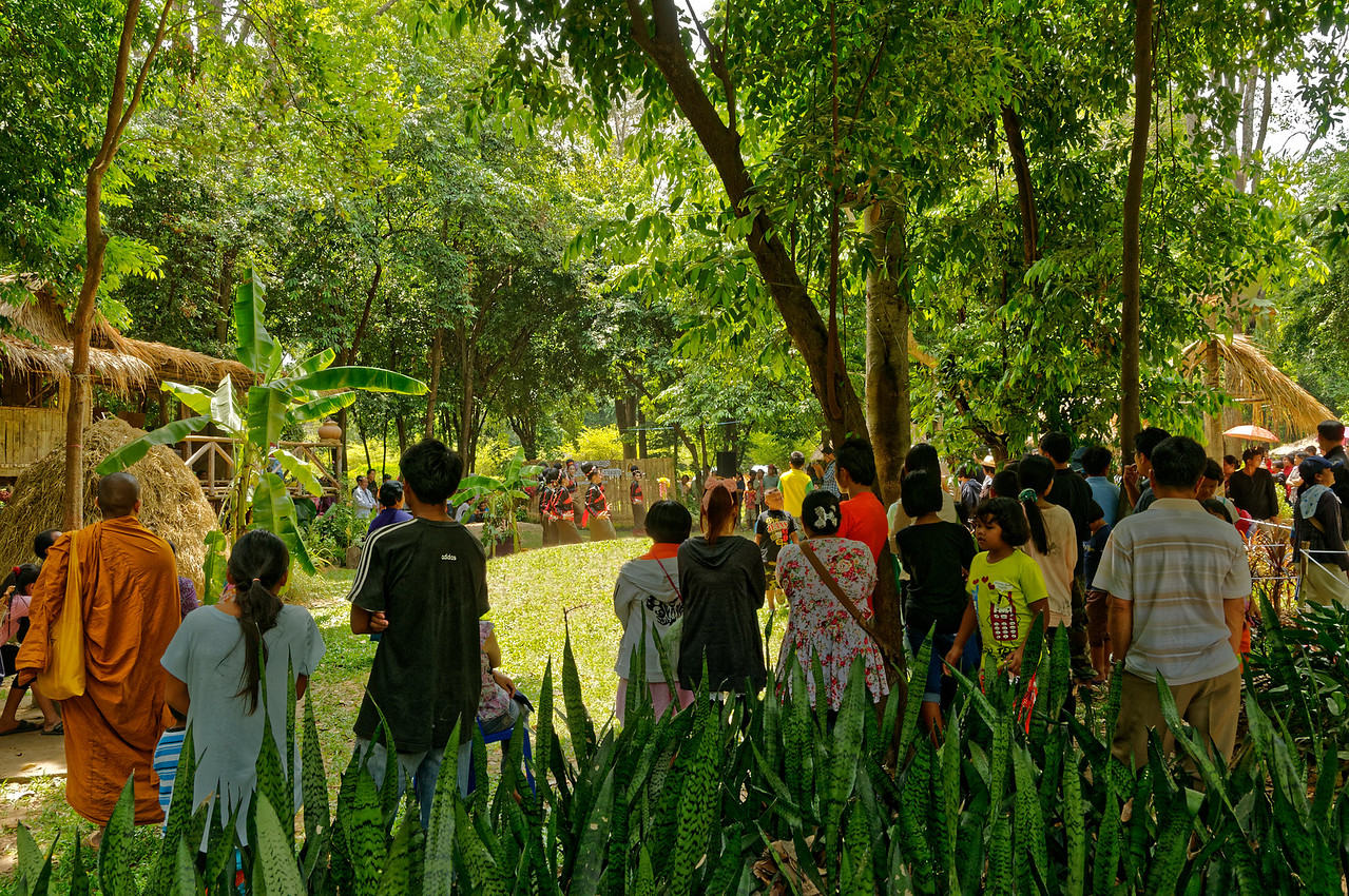 A crowd gathers to watch the opening of a performance by Suay dancers.