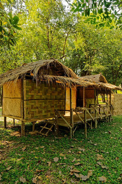 As part of the festival, historical house styles are recreated by each of the four tribes. Seen here and in the next photo are views of a typical early Khmer home, with sleeping room on one side, kitchen on the other. The thatched-roof structure has walls and floors made from bamboo strips.