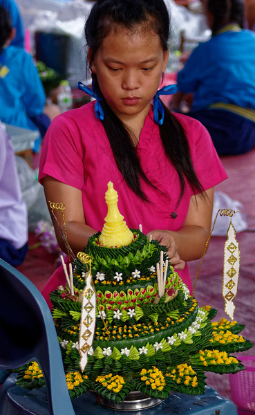 The <i>krathong</i> are made of banana leaves, which are topped with flowers, candles, and incense sticks. Some school districts hold <i>krathong</i>-making competitions for their students. The student photos in this gallery were taken during such a competition in Chiang Mai, in the north of Thailand.
