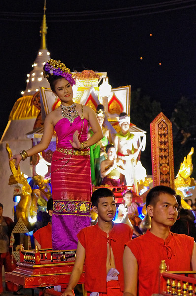 That same day, at night, the festival's parade makes its way through the streets of Chiang Mai. The festivities will continue on the following night as well.
