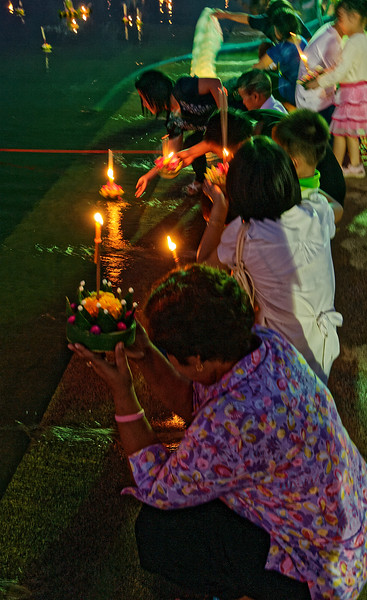 A prayer is usually offered before each <i>krathong</i> is launched.