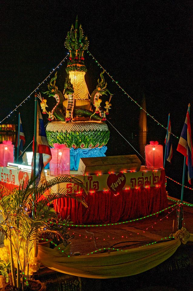 Many of the large-scale <i>krathong</i> at the festivals mine the rich resources of Thailand's past for inspiration and subject matter. Here, the snakelike creatures near the top of this float derive from ancient Khmer <i>naga</i>—and ultimately from Hindu and even earlier animist cults.