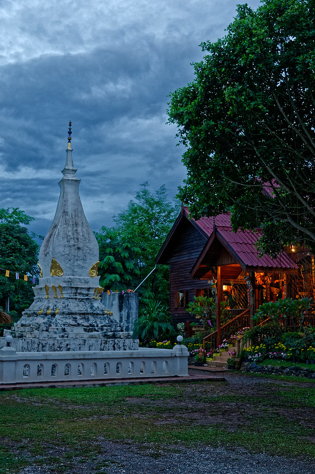 This view inside the local temple grounds, taken as darkness was descending, includes a glimpse of the small <i>Phi Tha Khon</i> museum, right, which contains a collection of masks and accompanying commentaries that outline their history and evolution over the years.