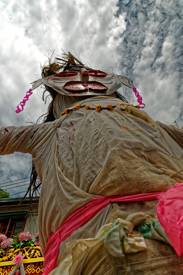 Among the ghosts at the festival, two giant, seriocomic fertility figures, <i>phi tha khon yai,</i> male and female, represent abundance in general: of crops, of offspring, and in matters of business. The whirling male giant is seen here.