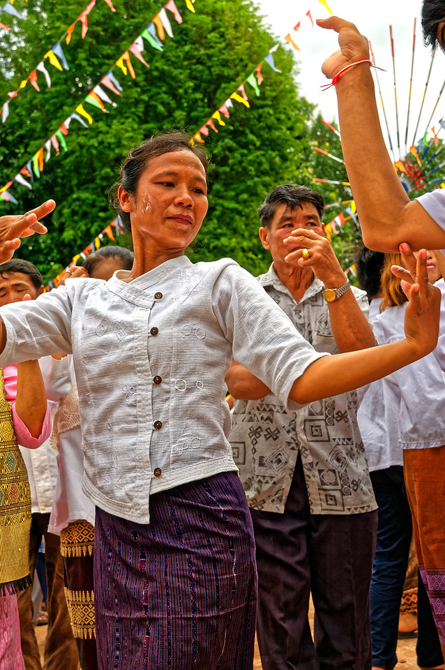 On the main day of the <i>Phi Tha Khon</i> festival, people gather in the courtyard of the local temple, where music and dancing begin.
