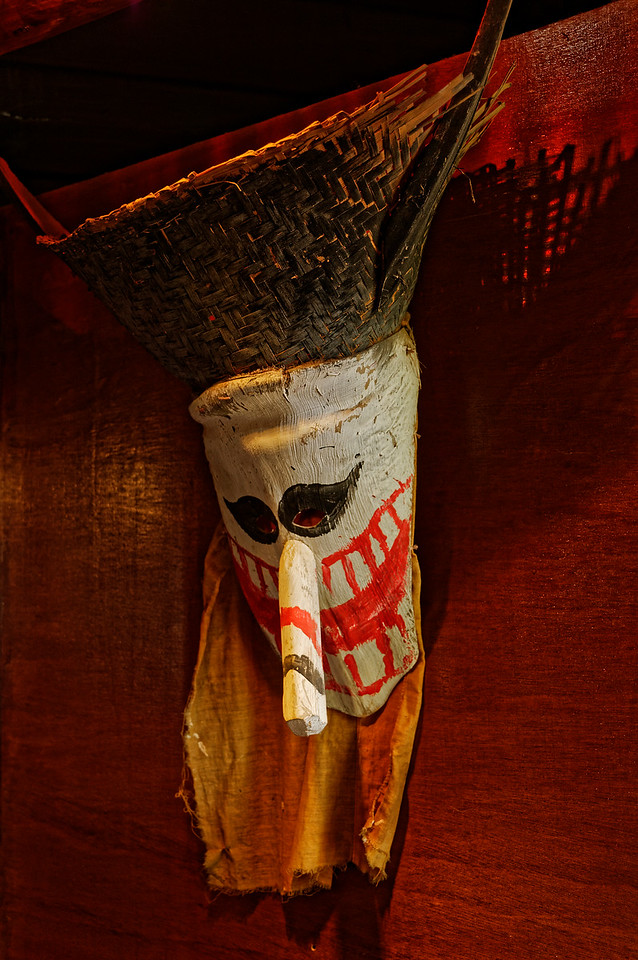 The <i>Phi Tha Khon</i> masks combine three main components: a hat, face, and nose. The hat is fashioned from a <i>huad,</i> a woven-bamboo container used to steam sticky rice, which is folded along the bottom to conform to the size of the wearer's head.