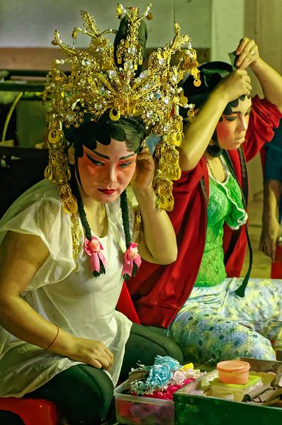 Actresses prepare their makeup, pre-performance.