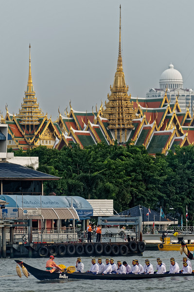 The temple in the background is Wat Phra Kaeo, Temple of the Emerald Buddha, on the grounds of the Grand Palace in Bangkok.