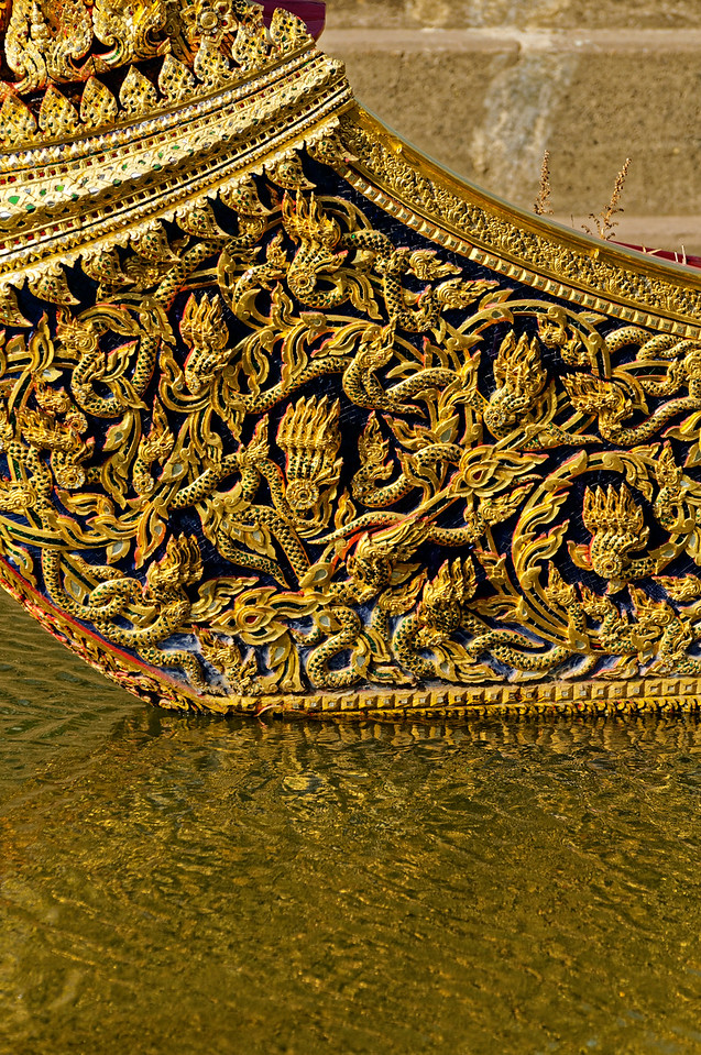 Another intricately carved hull, here with multiple <i>naga</i> motifs