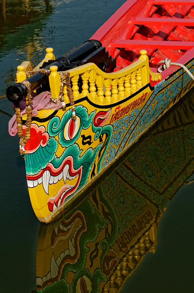 A barge whose stylized tiger's head design is Chinese-derived rather than ancient Hindu.