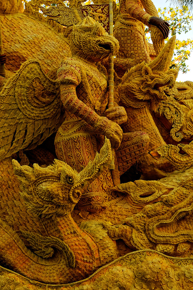Many of the floats display figures from ancient Hindu mythology, such as the part-human part-bird <i>garuda</i> seen here kneeling between two <i>naga.</i> The latter are serpentlike creatures who serve as the guardians of the earth's waters.