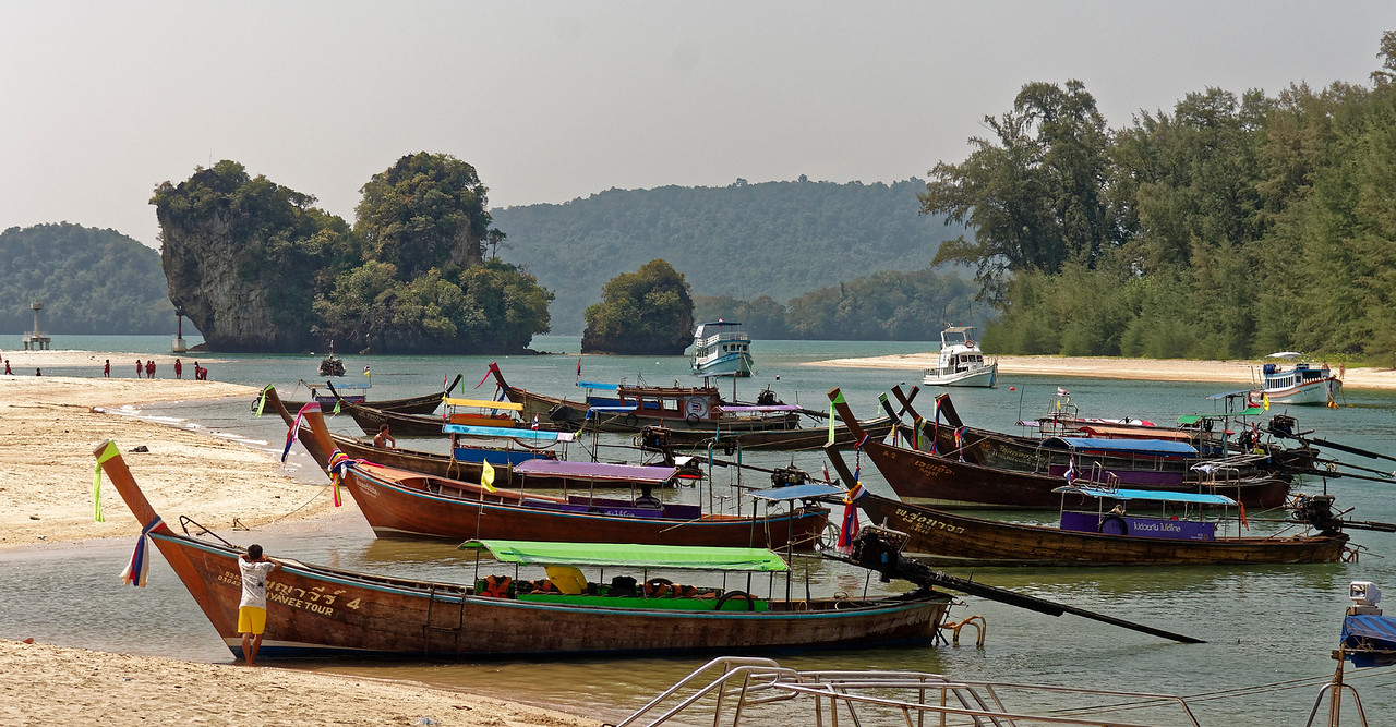 Longtail boats beached at a cove at Ao Nang