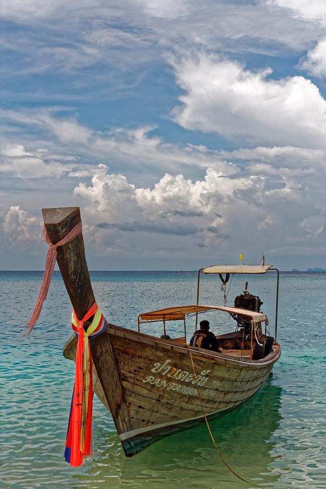 Longtail boat at anchor at Ko Hua Kwan