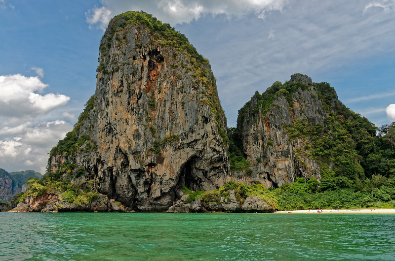 Limestone cliffs at the end of West Railae beach. Railae is a peninsula on the Andaman Sea, separated from the rest of the mainland by limestone mountains, accessible only by boat.