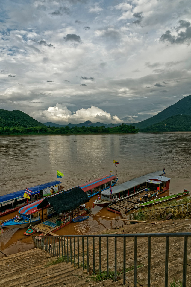 Boats moored at a landing in Chiang Khan at the end of the day