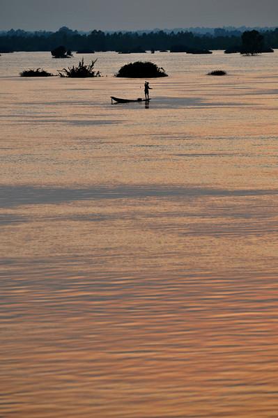 A fisherman takes advantage of the newly-formed 'lake' at Rasi Salai.
