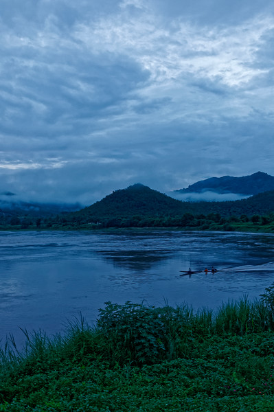 Early-morning fishermen on the Mekong River at Chiang Khan in the extreme north of Isaan, with Laos across the river in the background