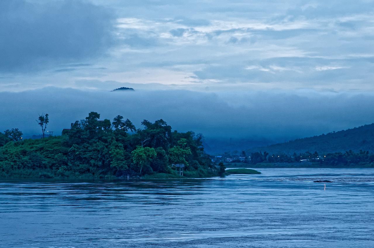 Fog-engulfed landscape at dawn along the Mekong at Chiang Khan