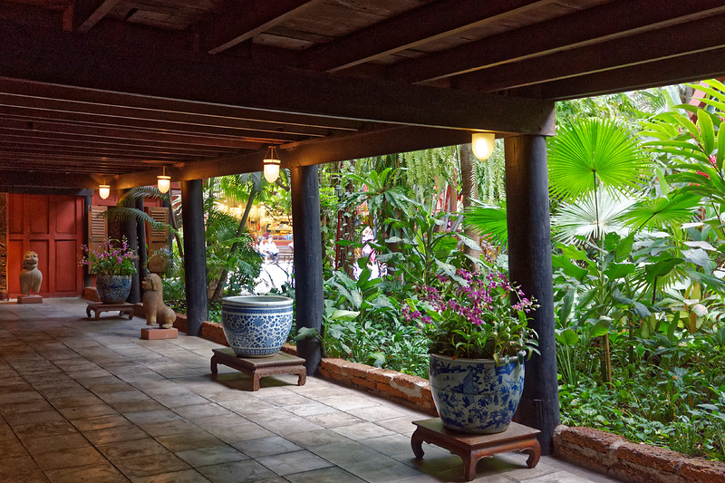 A patio overlooks a tropical garden area at the historic Jim Thompson House.