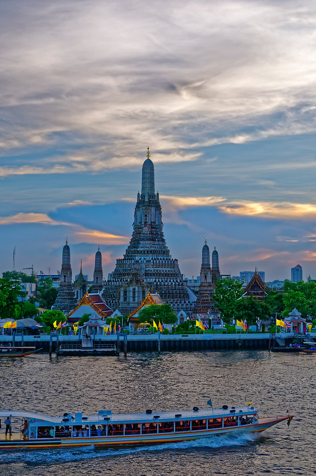 Wat Arun, Temple of the Dawn, with a passenger ferry on the Chao Phraya in the foreground