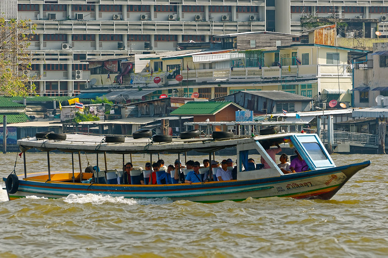 One of the many commuter ferries on the Chao Phraya