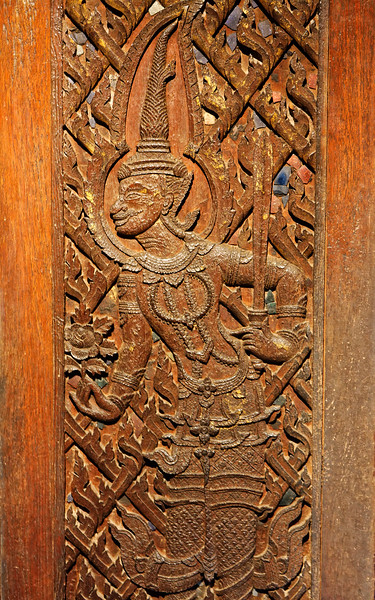 Carved wooden door at the Jim Thompson House