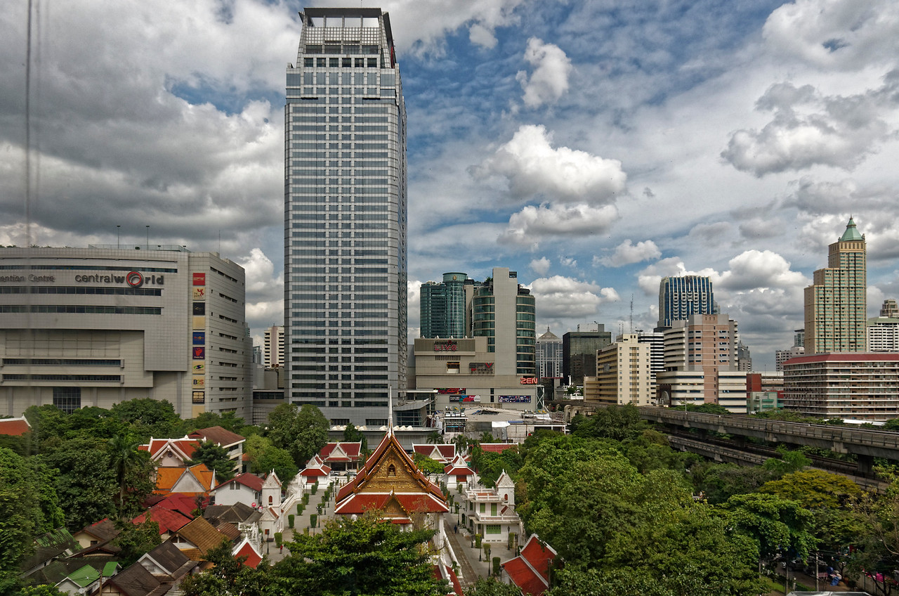 View of Bangkok's central shopping district, with Wat Pathum Wanaram in the foreground. The royal temple was built in 1857 by Mongkut, Rama IV, to serve as a place of worship near his Sa Pathum Palace.