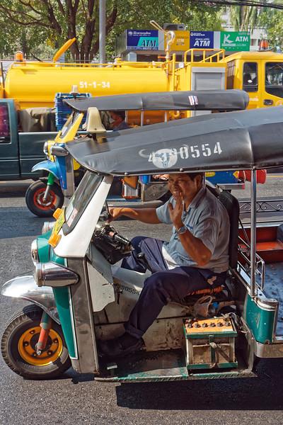 A friendly Bangkok <i>tuk-tuk</i> driver
