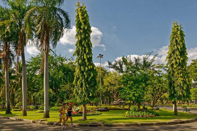 Lumpini Park, a favorite spot for joggers, offers a green respite from the heat and bustle of the city.