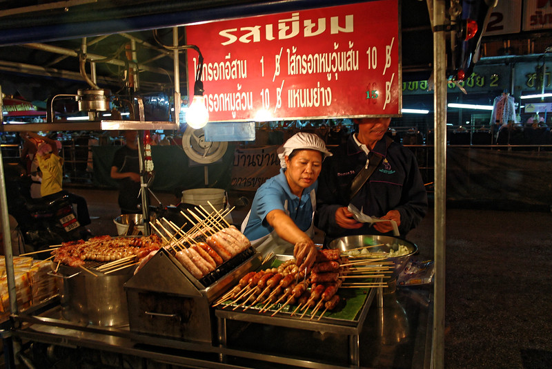An Isaan native transplanted to Chiang Mai, selling 'Isaan sausages.' The sausages are made with pork, garlic, and either rice or glass noodles.