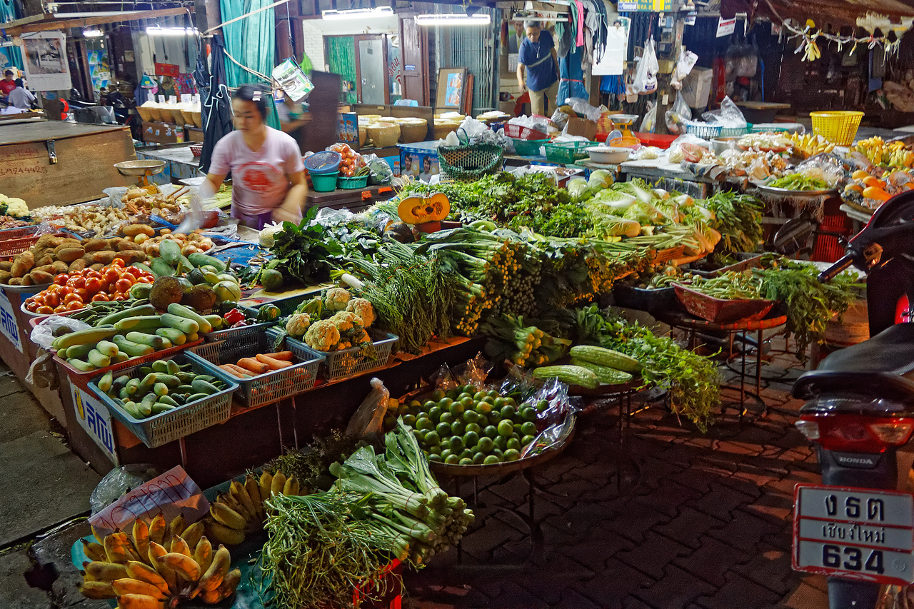 Fresh fruits and vegetables along the sidewalk on Moon Muang Road