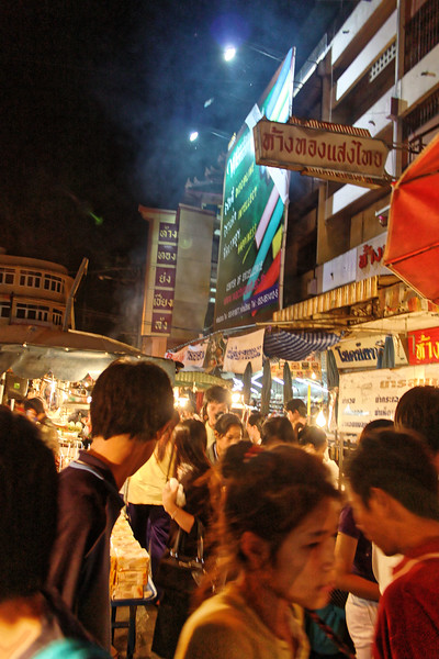 At night, the streets around Chiang Mai's Warorot Market overflow with shoppers.