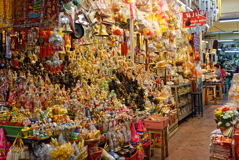 An avalanche of religious objects—for placement at shrines, businesses, or in the home—erupts at Warorot's indoor market.