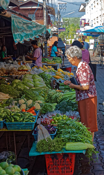 Checking out the morning's fresh produce inside Chiang Mai's old walled-city area