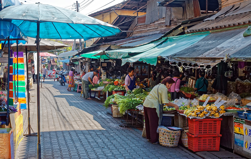 Stalls selling fresh produce along a lane off of Moon Muang Road
