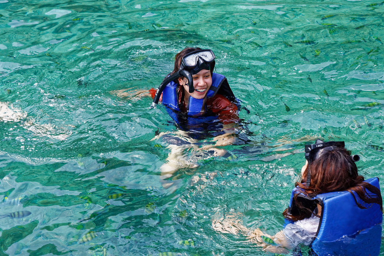 """Snorkeling among the fishes at Ao Ling, """"Monkey Bay,"""" off Phi Phi Don Island, southern Thailand"""