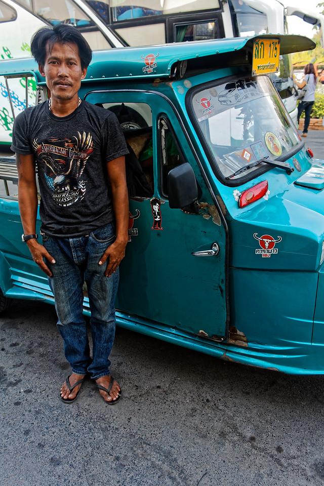 <i>Tuk-tuk</i> driver and his vehicle, Ayutthaya, central Thailand