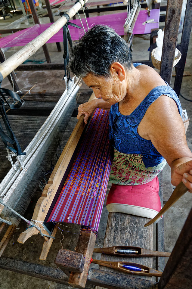 Silk weaver at her loom, Bung Boon