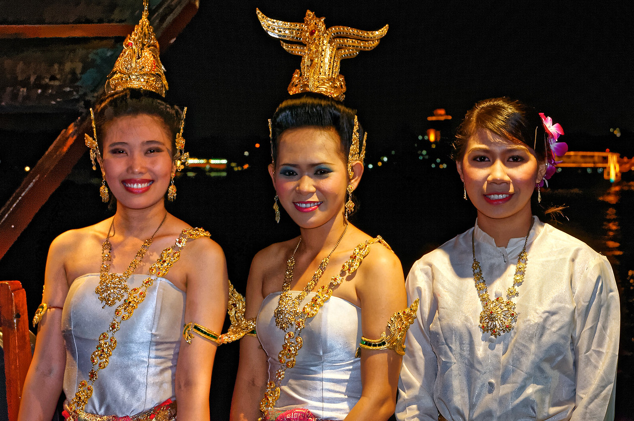 Dancers and musicians aboard a converted rice barge now used for dinner cruises on the Chao Phraya River, Bangkok