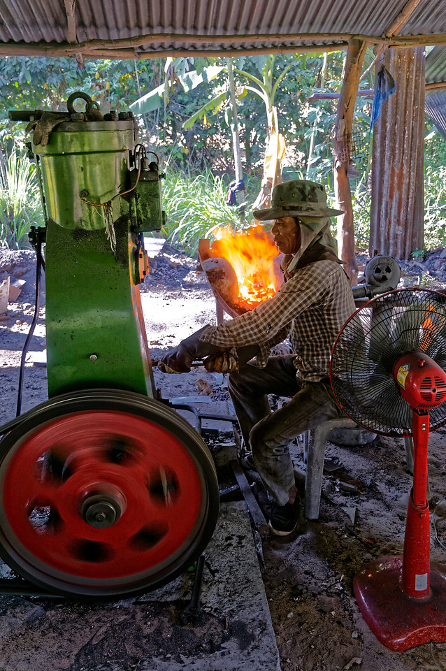 At Baan Nong Yai in Isaan's Sisaket Province men labor in an intense tropical heat heightened by the fires of their forges—cutting, hammering, fashioning, and polishing knives for the marketplace.