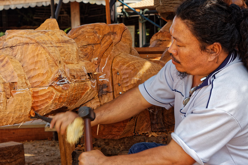 Wood sculptor at Prasat Sutja Tum, the Sanctuary of Truth, Pattaya