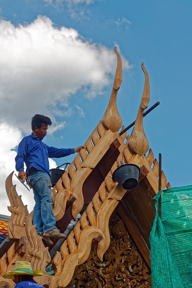Installing new bargeboards and traditional Thai birdlike finials called <i>chofa,</i> Wat Pho, Bangkok