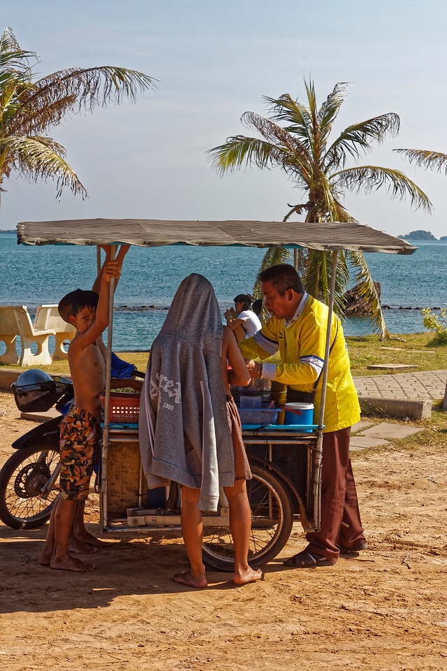 Ice cream vendor on the beach at Rayong, on the Gulf of Thailand