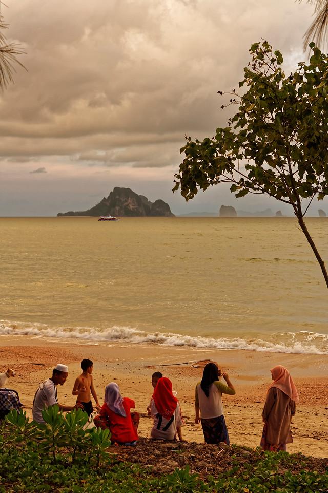 Muslim family at dusk on the beach at Ao Nang